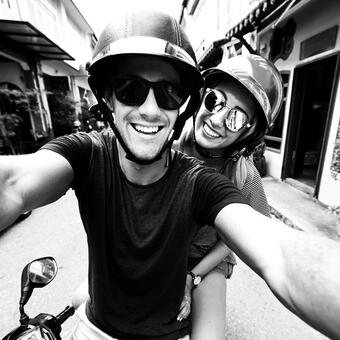 Kayak Hero Image: Man and Woman on a bike smiling
