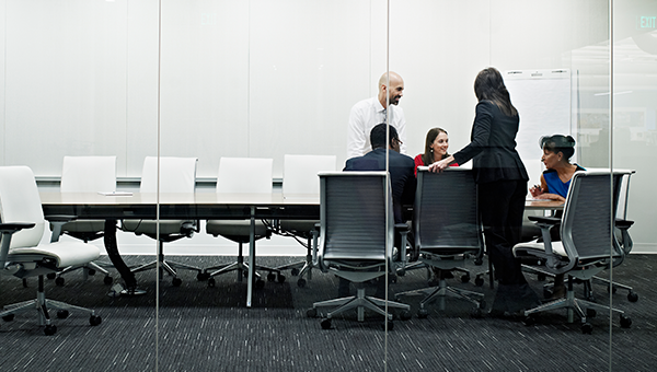 Professional people working in a modern conference room.