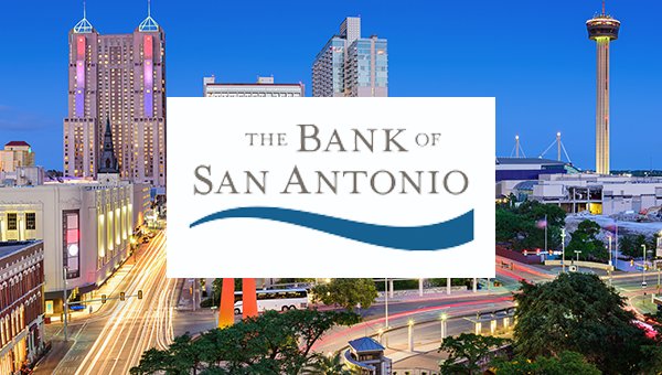 The Bank of San Antonio Logo over the San Antonio skyline at night.