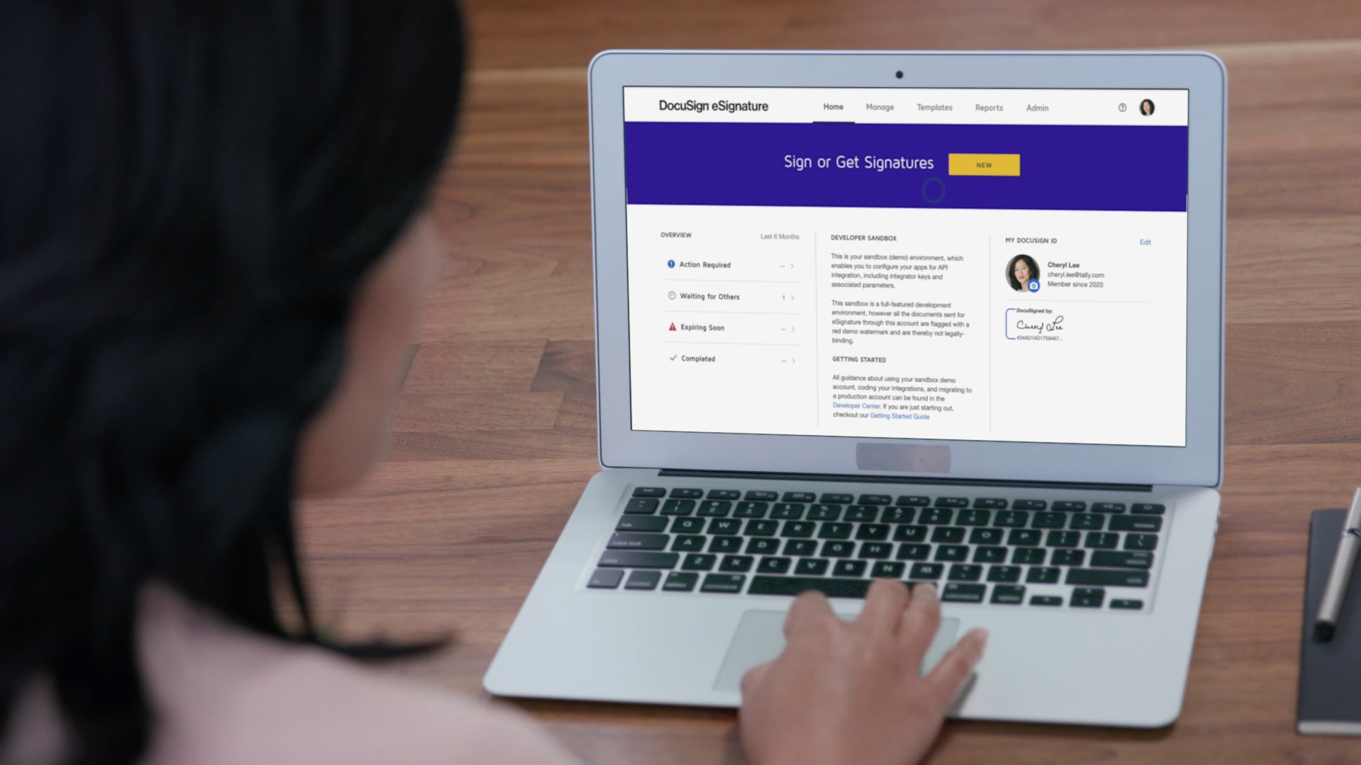 Woman on a Macbook Air using DocuSign eSignature.