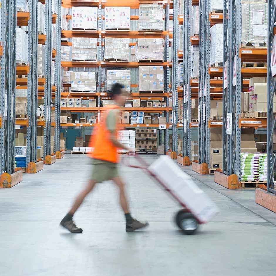 Warehouse employee quickly executing fulfillment requests thanks to DocuSign Agreement Cloud for Procurement.