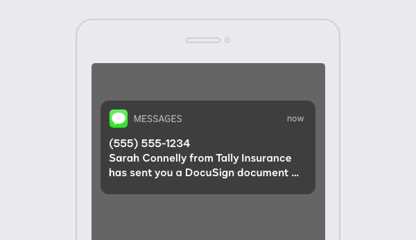 A cellphone with a text notification from DocuSign eSignature SMS Delivery.