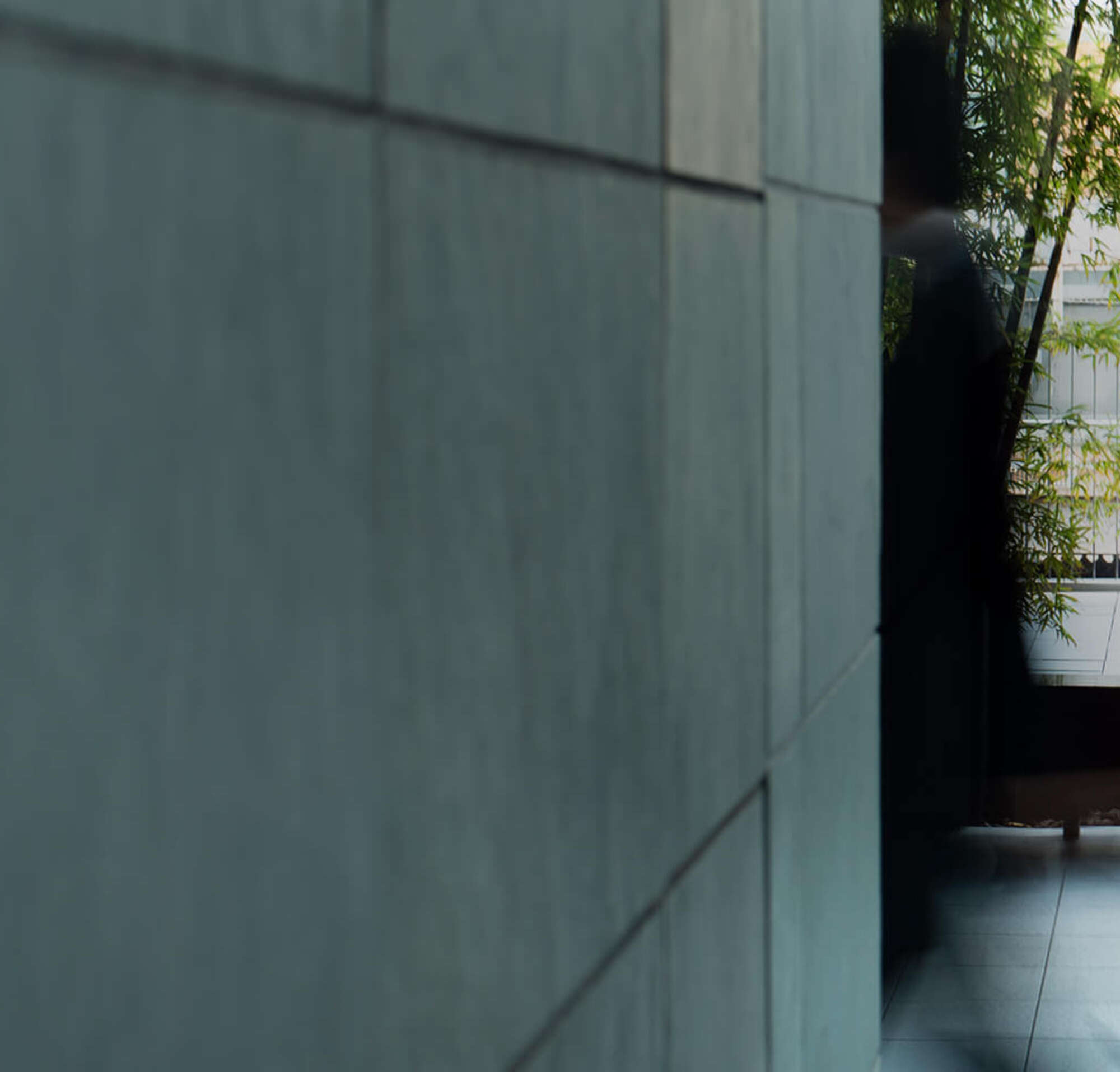 A long exposure image of people walking through a modern atrium.