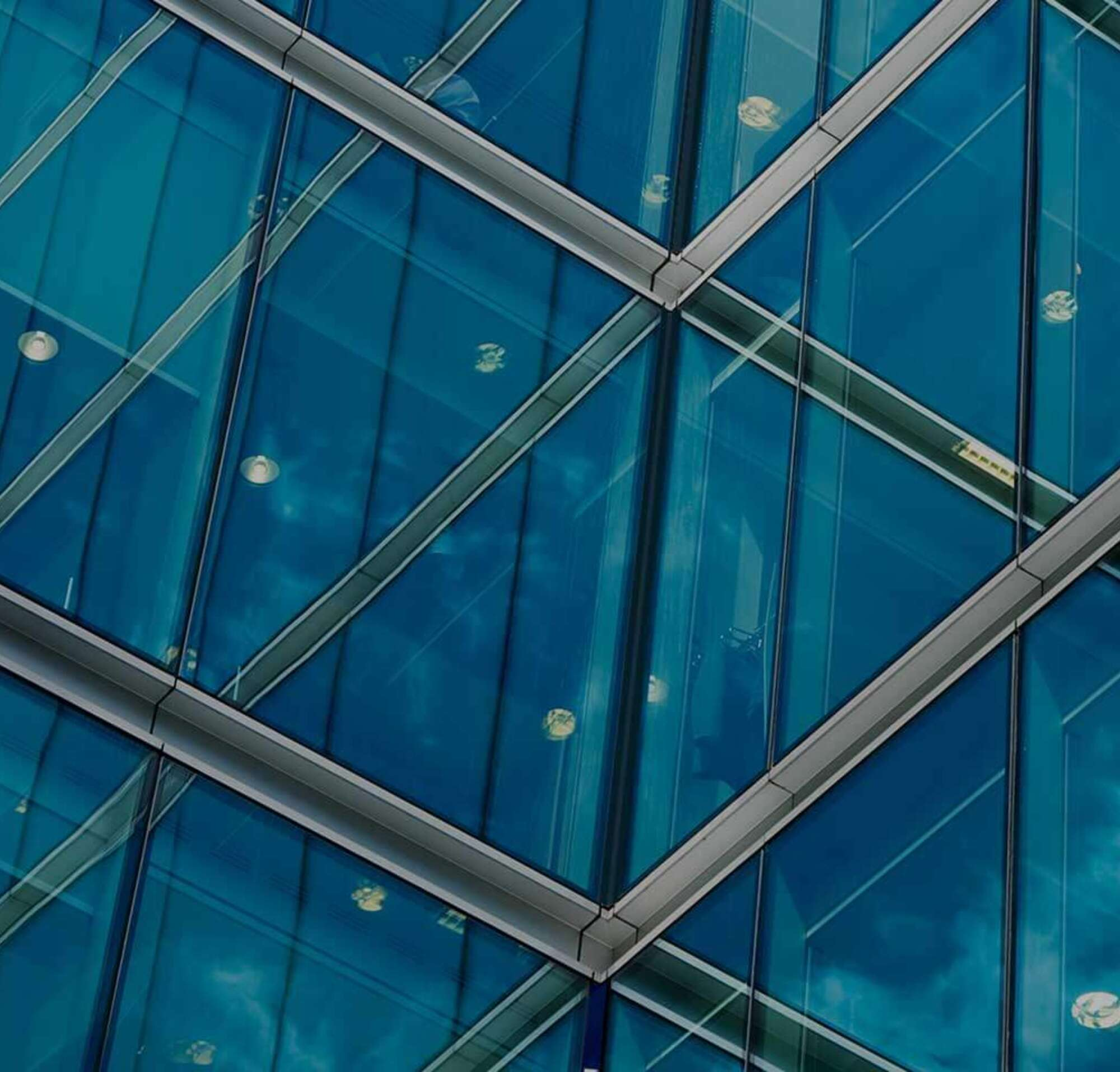 The corner of a glass high rise.