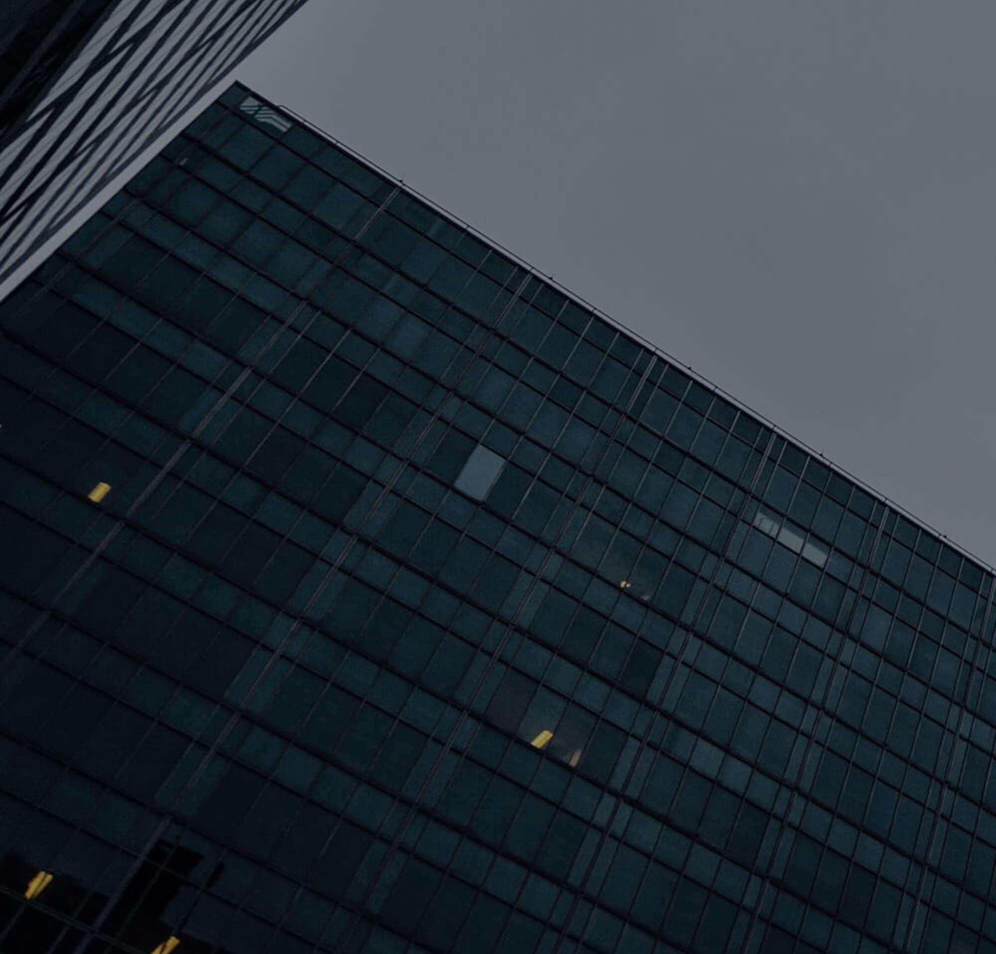 skyscraper office building representing DocuSign legal department client locations.