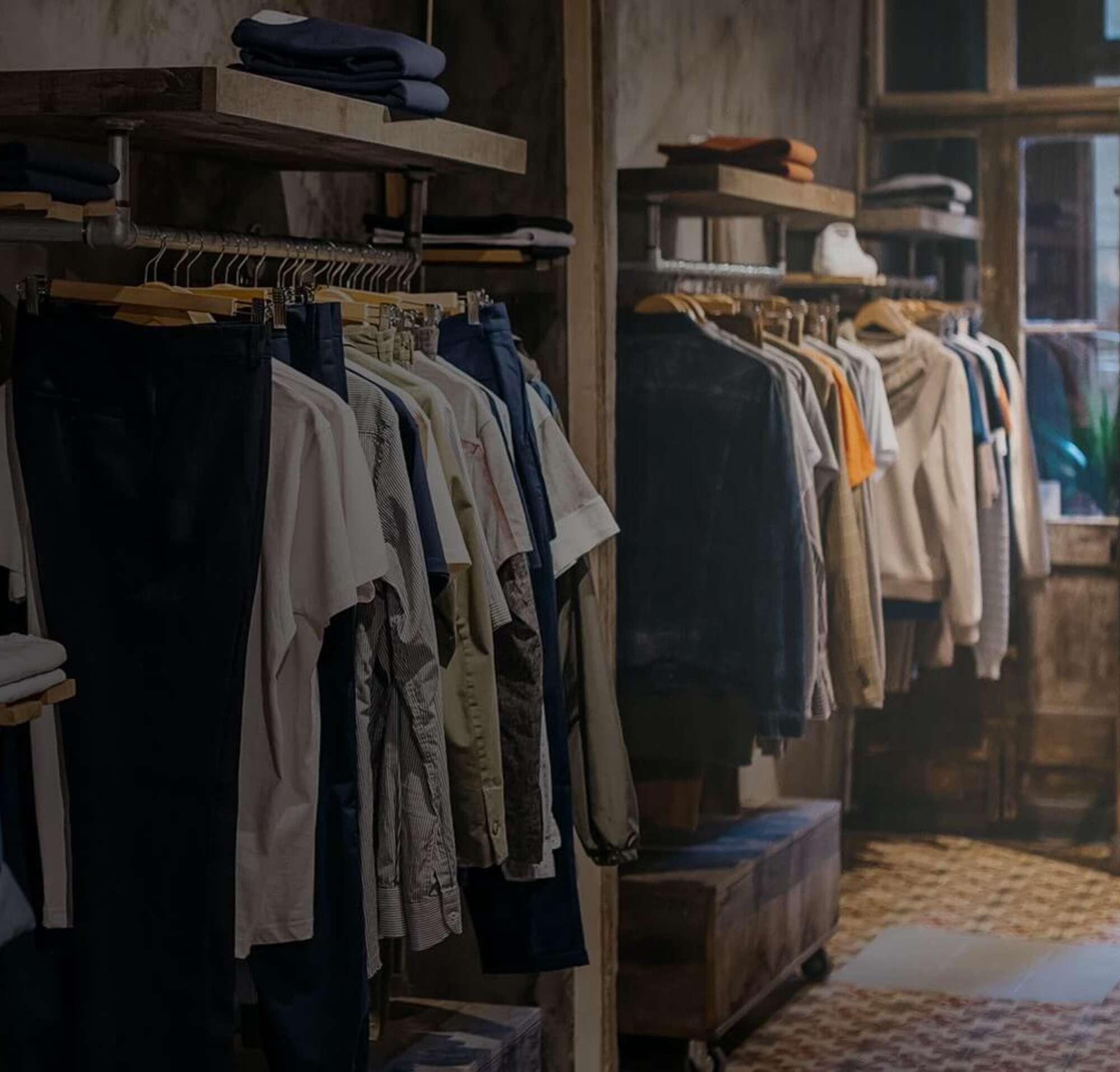 A clothing rack inside a shop.