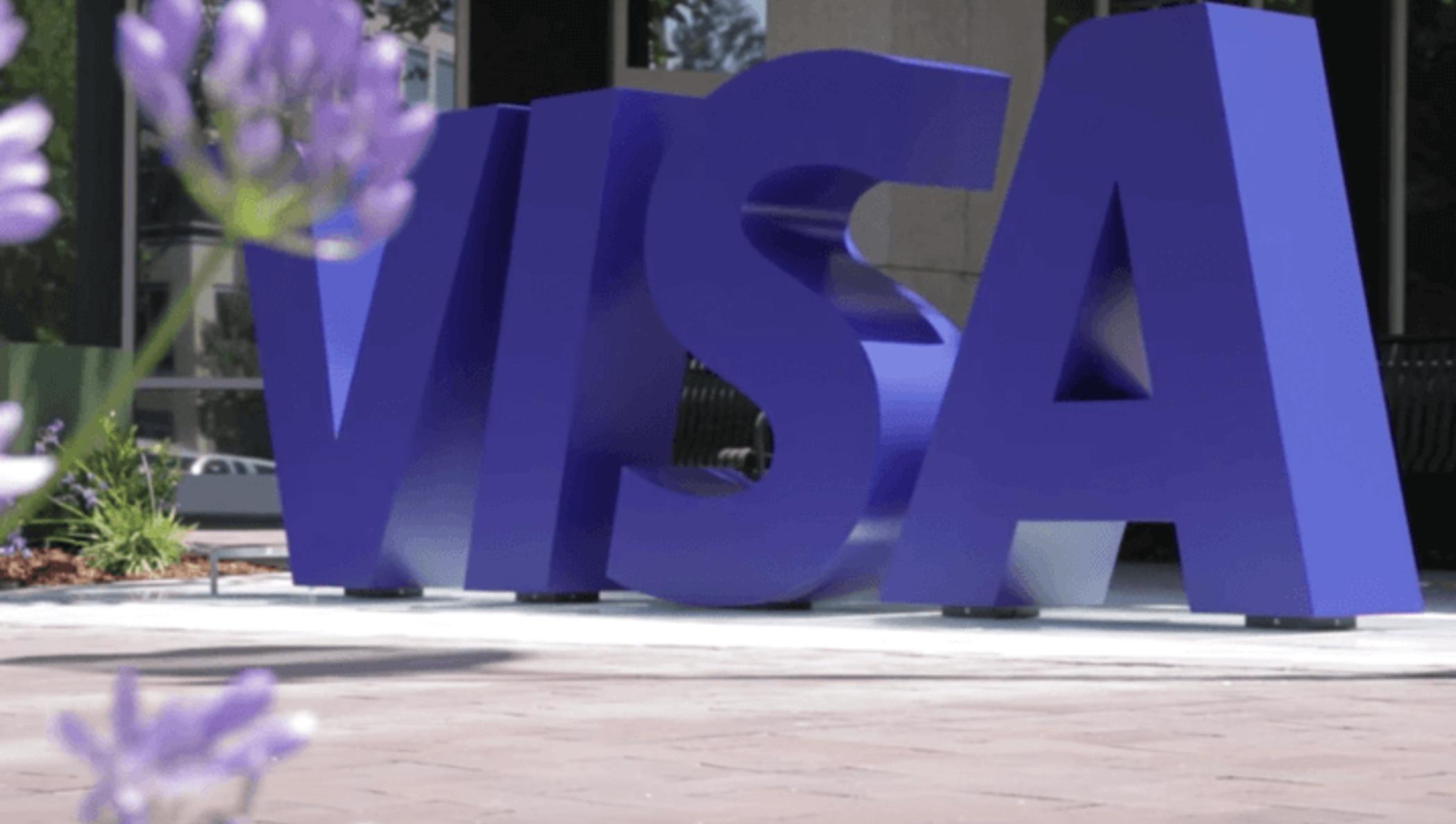 An outdoor sculpture of the VISA logo.