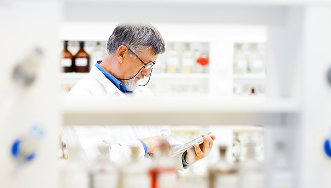 Lab worker with DocuSign's vaccine management for government agencies.